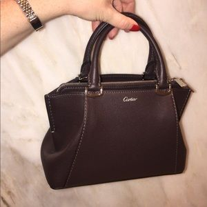 Cartier bag. Comes with body strap